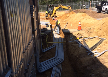 Aucoin Telecom installing undergroud conduit for emergency generators