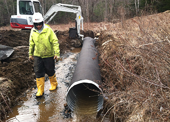 Aucoin Telecom installs drainage culverts for Right of Way maintenance